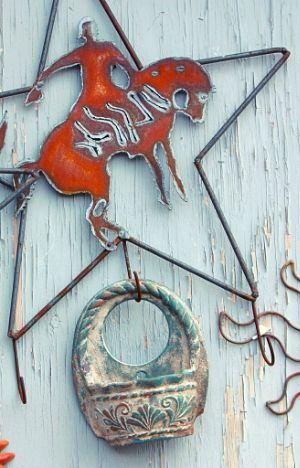 metal star and charm on farmhouse wall